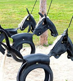 old tires turned into swings.