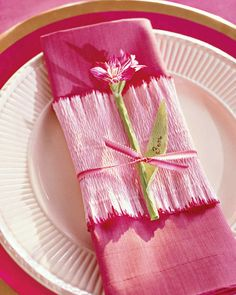 "Follow directions for ""Potted Amaryllis Gift Wrap,"" but measure and cut the crepe paper to fit a folded napkin or a gift box. Omit the card-stock cuff. Wrap crepe paper around napkin or box (covered in gift wrap in a coordinating color). Tie with ribbon, and tuck in a crepe-paper amaryllis. SourcesCrepe paper in Light Pink (CR9), Gentle Pink (CR10), White (CR16), Dark Red (CR8), Pale Pink (CR27), and Light Pink (CR26), from Roze, and similar, from D. Blumchen & Co., 866-653-962..."