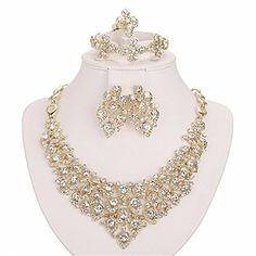 Moochi 18K Gold Plated White Crystal Embedded Scarf Pattern Jewelry Set    Prices & See More Please   Follow the Description Link  http://amzn.to/2tCUCJV