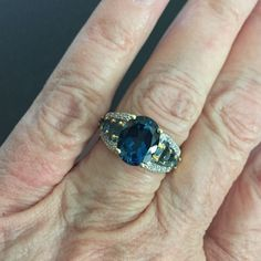 Blue topaz ring 10k Beautiful blue topaz ring set in 10 k gold.  This would make a beautiful wedding band!  Approximately 10mm oval center stone with three stones on each shoulder. Sz 7, new with tag. Jewelry Rings