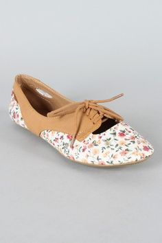 I love the floral pattern and the cut out holes. Such a girly take on the oxford shoe.