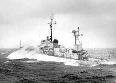 """""""The 255-ft. U.S. Coast Guard Cutter ESCANABA, based at New Bedford, Massachusetts, takes a salty shower bath in rough North Atlantic weather on ocean station 'Delta', 650 miles southeast of Newfoundland and east of Nova Scotia"""