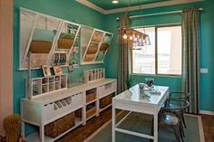 Craft Space - with craft space center cubby organzier, Madison Wall Mounted Laundry Drying Rack, Craft Space Table by Martha Stewart, Frazee Paint Color #CL 3043W - Space designed by Meritage Homes, Phoenix AZ