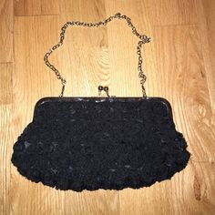 Black flowered clutch Black flowered. Inside compartment. Could be used as a mini purse Bags Clutches & Wristlets