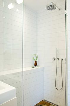 Stacked oversized subway tile with grey grout