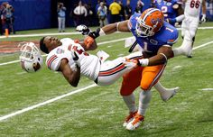 Florida linebacker Jon Bostic dislodges the helmet of Louisville quarterback Teddy Bridgewater during the first quarter of Wednesday's Sugar Bowl. Despite the hit, Bridgewater led the Cardinals to a 33-23 victory. (AP Photo/Bill Haber)