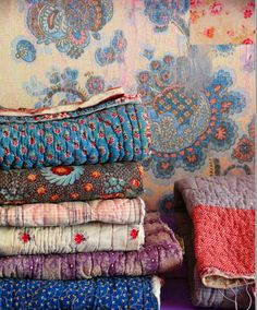 A stack of beautiful quilts - - what I want in my home someday!