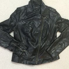 """✨FINAL PRICE✨Express faux leather jacket Classic with a twist! Express black faux leather jacket w/asymmetrical zipper, zippered cuffs - a stunner! Gently used (bottom photo shows minimal normal wear at cuffs near zippers & at hem). See comments. Many compliments on this amazing jacket!! Please ask any questions prior to purchasing. Thank you! Approx measurements flat: top of shoulder to hem 22.25"""", armpit to armpit 18"""", outer seam of shoulder to cuff 25"""". Happy Poshing! Express Jackets…"""