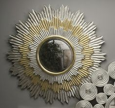Weaver Handcarved Mirror - Silver leaf gives the impression of cast metal in each of these hand carved wood mirrors. 47d
