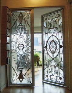 art deco glass doors -- Love that they are different... Would be so nice going into a master bath or den