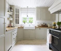 gray kitchen cabinets and butcher block countertops