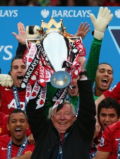 """Raise It Up!!!! Fitting end Sir Alex Ferguson lifts the Premier League trophy for the final time at Old Trafford. """"You have been the most fantastic experience of my life.'' Sir Alex Ferguson gives emotional farewell speech at Old Trafford."""