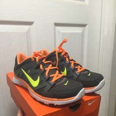 Nike Flex Supreme TR 2 Excellent condition. Dark Grey with atomic orange  and yellow.  I love these, they just do not fit.  No signs of wear.  Would be interested in trading for a 6. Nike Shoes Athletic Shoes