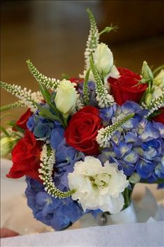 Blue hydrangea, freedom roses, lisianthus, and veronica make a pretty patriotic bouquet