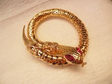 red rhinestone eye mesh wrap snake bracelet  we also have the silver tone mesh and blue eye selections
