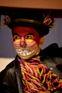Detailed makeup and costume for the cheshire cat
