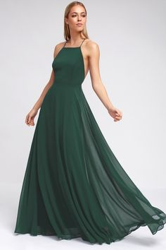 The Mythical Kind of Love Dark Green Maxi Dress is simply irresistible in every single way! Lightweight Georgette forms a fitted bodice with princess seams and an apron neckline supported by adjustable spaghetti straps that crisscross atop a sultry open back. A billowing maxi skirt cascades from an elasticized waistline into an elegant finale, perfect for any special occasion! Hidden back zipper with clasp.
