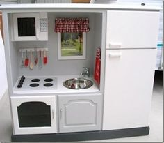 TV Cabinet repurposed to a child's kitchen  |  http://cheneybaglady.blogspot.com/2011/07/smart-tips-tuesdays_26.html