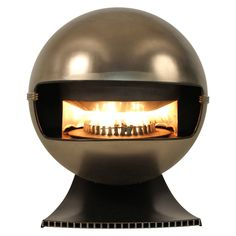 Model 2000 Fireplace By Richard Wolthekker For Faber 1965 | From a unique collection of antique and modern fireplaces and mantels at https://www.1stdibs.com/furniture/building-garden/fireplaces-mantels/