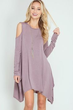 I dislike the cold shoulder look and the super flow-y, shapeless dress, and the washed out color.