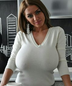 Merilyn Sakova - in white V-neck sweater