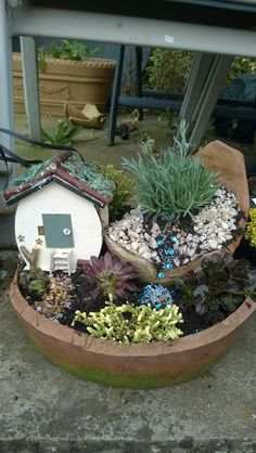 The Great Annual Miniature Garden Contest sponsored by Two Green Thumbs Miniature Garden Center. This entry for International Miniature Garden Category by Carol.