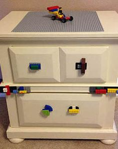 A Lego play table made out of an old side table. I really like the Legos as drawer knobs. I'd probably try to cover the entire top with the Lego surface piece though. Lego Play Table, Lego Table With Storage, Lego Storage, Kids Storage, Lego For Kids, Diy For Kids, Old End Tables, Diy Kids Furniture, Diy Wood Projects