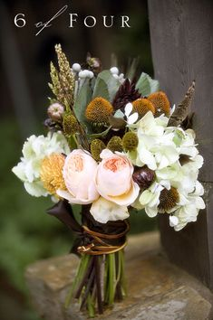 Beautiful bouquet! I love all the natural elements against the soft peonies.