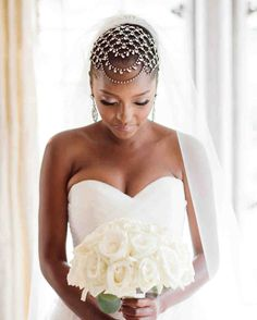 The Best Hairstyles for Every Wedding Dress Neckline | Martha Stewart Weddings - Case in point? This sleek, pulled-back hairstyle keeps a jewel-encrusted headpiece from looking too over-the-top. #weddinghair #weddinginspiration #hairstyle #wedding #weddinghairdo