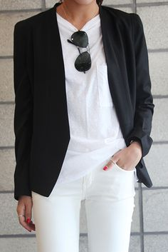 all white: white jeans, white tee and black blazer