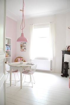 white & pink- and I like the little stove in the corner.