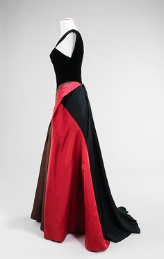 side view Evening dress Designer: Charles James (American, born Great Britain, 1906–1978) Date: 1946 Culture: American Medium: silk/rayon, silk Dimensions: Length at CB: 58 in. (147.3 cm) Credit Line: Brooklyn Museum Costume Collection at The Metropolitan Museum of Art, Gift of the Brooklyn Museum, 2009; Gift of Arturo and Paul Peralta-Ramos, 1954