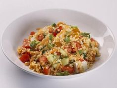 Vegetarian bulgur wheat pilaf with onions, bell pepper and celery