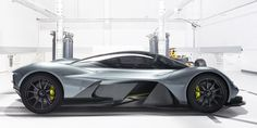This car formally known as Aston Martin - Red Bull AM-RB 001 was created over a pint at a pub. Aston Martin President Andy Palmer and Red Bull Racing's Adrian Newey and Christian Horner partnered together to create this multi-million dollar car. Red Bull F1, Red Bull Racing, Auto Motor Sport, Sport Cars, Martin Car, Aston Martin Lagonda, Geneva Motor Show, Most Expensive Car, Car Prices