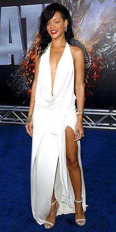 RIHANNA  The battle continues: Rihanna makes a major strike in a draped, high-slit white gown, nude sandals and Neil Lane gems for Battleship's L.A. premiere.