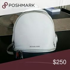 Michael Kors Rhea Backpack Black and white with silver details Michael Kors backpack. It has 3 compartments and lots of pockets inside. I include a Michael Kors leather cleaner with a microfiber towel for cleaning purposes. Also include dust bag. Michael Kors Bags Backpacks