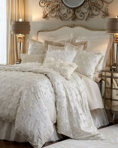 Love the white and off white together! very elegant! and I love the shear fabric on the bed skirt!