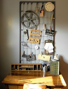 Crib mattress springs as inspiration wall above desk -- very cool.
