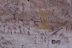 Dancing human figures in the Cave of Beasts in the Wadi Sura in Egypt, near the border of Libya and Sudan, in the Sahara Desert - photo by Clemens Schmillen, via Wikipedia;  The people are over-painted with yellow pigmented creatures. The art is more than 7,000 years old, and has about 5,000 figures.     https://en.wikipedia.org/wiki/Cave_of_Beasts