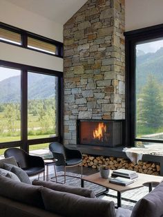 Stone Corner Fireplace Design Living Room big windows like yours are painted black for a graphic effect. Picture big blinds instead of curtains. Modern smal chairs room ideas with fireplace Top 70 Best Corner Fireplace Designs - Angled Interior Ideas Home Fireplace, Living Room With Fireplace, Fireplace Design, Fireplace Ideas, Fireplace Modern, Modern Stone Fireplace, Corner Fireplaces, Fireplace Furniture, Fireplace Windows