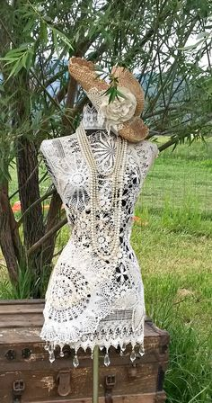 doily covered dress form
