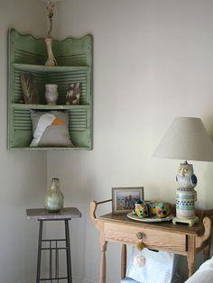 Shutters as a corner shelf, hang on wall for cottage style home decor; upcycle, recycle, salvage, diy, repurpose!  For ideas and goods shop at Estate ReSale  ReDesign, Bonita Springs, FL