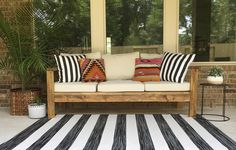 Outdoor Sofa 2x4 Project http://www.ana-white.com/2014/07/plans/outdoor-sofa-2x4s-ryobi-nation #appleandwren #anawhitediy #outdoorstaging #staging #homestaging #patio decor