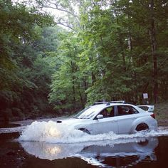 Subaru wrx plowing through water