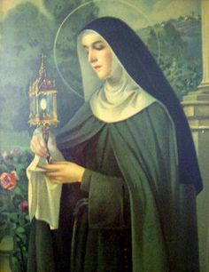 St. Clare, who brought the Eucharist out to defend her city from invaders.