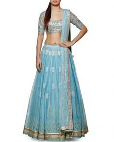 This Powder blue lehenga skirt is in woven texture and blouse of this lehenga set is in gota patti work. This lehenga hemlines are embroidered and embellished. The Dupatta of the lehenga set is in net