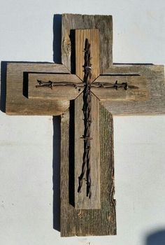 Check out this item in my Etsy shop https://www.etsy.com/listing/207351806/rustic-wood-cross-with-barbed-wire