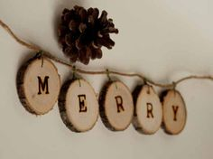 Modern Rustic Merry Christmas Tree Ring Garland via Etsy.  I need to do this...I have the woodburning letters