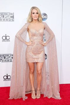 Carrie Underwood rocks a cape and dress designed by Elie Madi