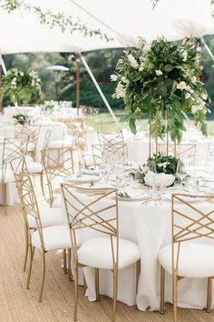 Laurel & Rose destination wedding in California. White and green wedding reception, large greenery centerpieces, white and gold table setting, classic white table setting.